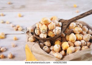 stock-photo-a-wooden-spoon-of-dried-chickpeas-on-a-chickpea-bag-449291566