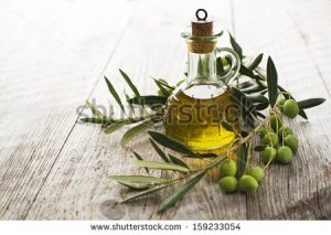 stock-photo-olive-oil-and-olive-branch-on-the-wooden-table-159233054